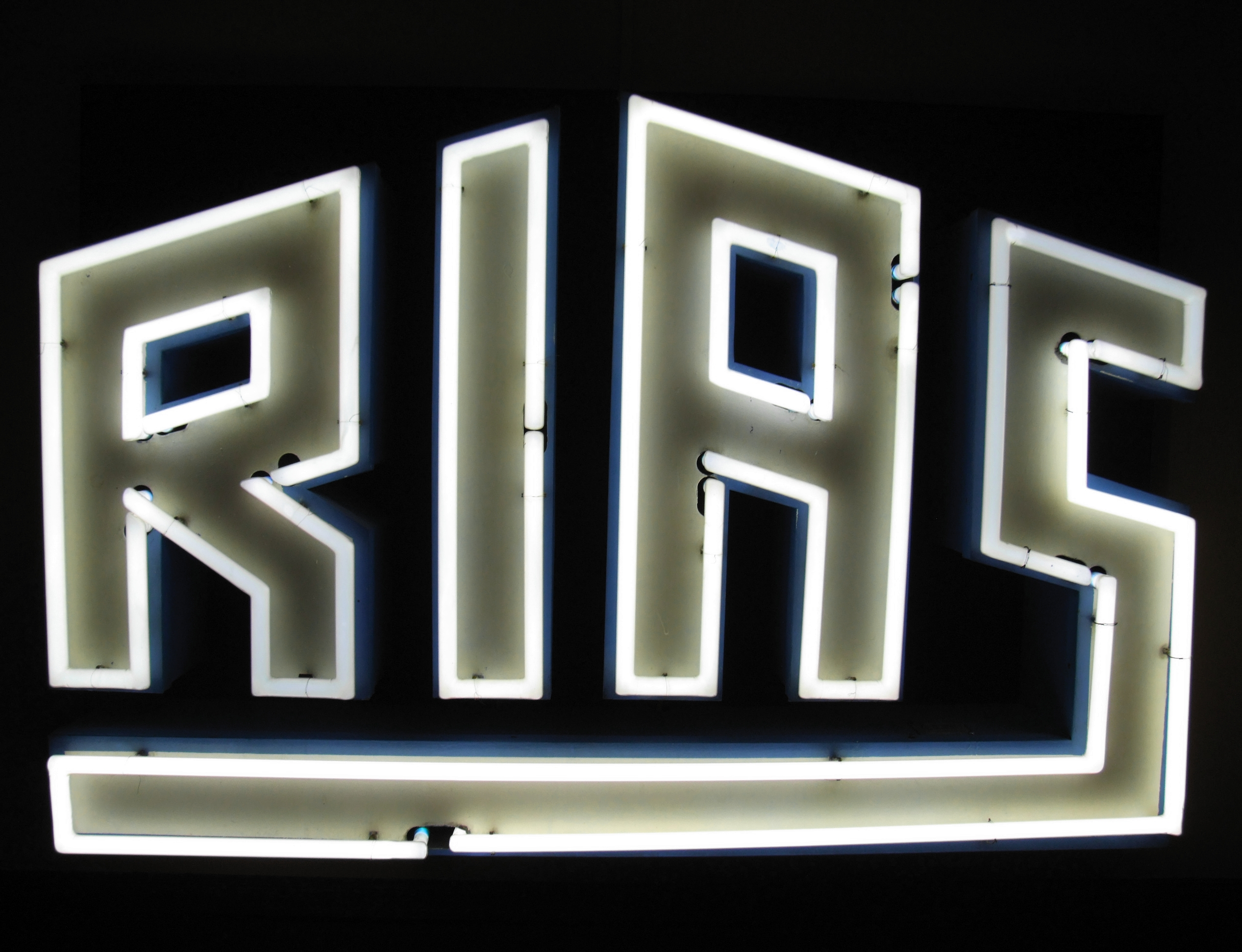 "The logo of ""RIAS"" in neon signs."