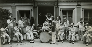 "Fred Waring and The Pennsylvanians, part of the ""Revue des Ambassadeurs,"" pictured in front of the club in 1928."