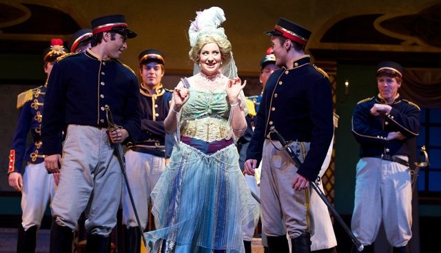 Gretchen Windt and her dashing soldiers, in an act 1 dance scene. (Photo: Ohio Light Opera)