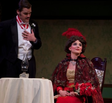 An explosive rendezvous with a bomb under the table: Natalie Ballenger as revolutionary Anetta Montarini and Clark Sturdevant as the (not so) LIttle King.