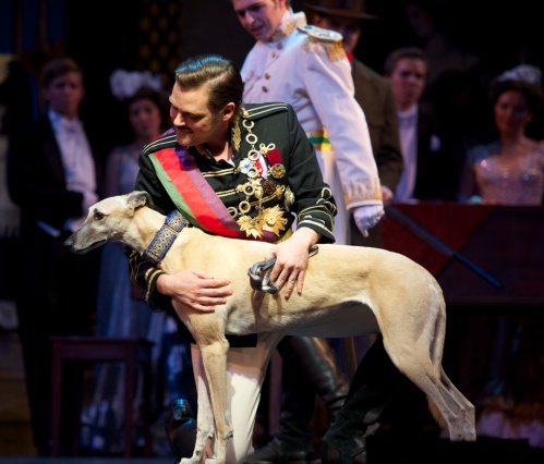 The abdication scene, in act 2, where the king (Clark Sturdevant) leaves his country to go into exile - with his dog. (Photo: Ohio Light Opera)