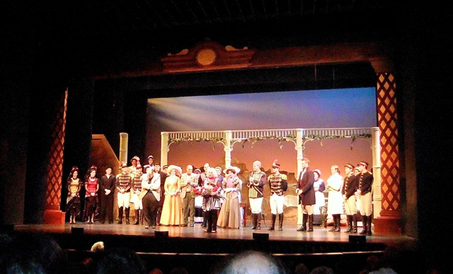 "Yvonne Kálmán thanking the cast of ""Little King"" on stage after the performance."