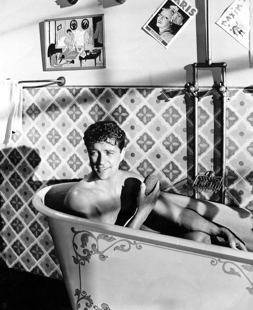 "A bath tub scene from the 1943 movie of ""Desert Song."""