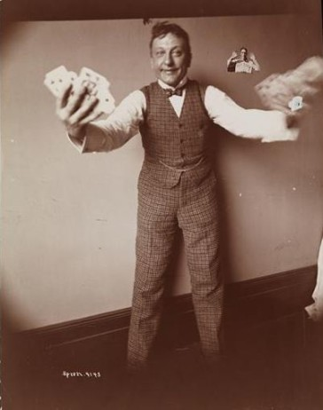 Henry Dixey playing a card trick, around 1900.
