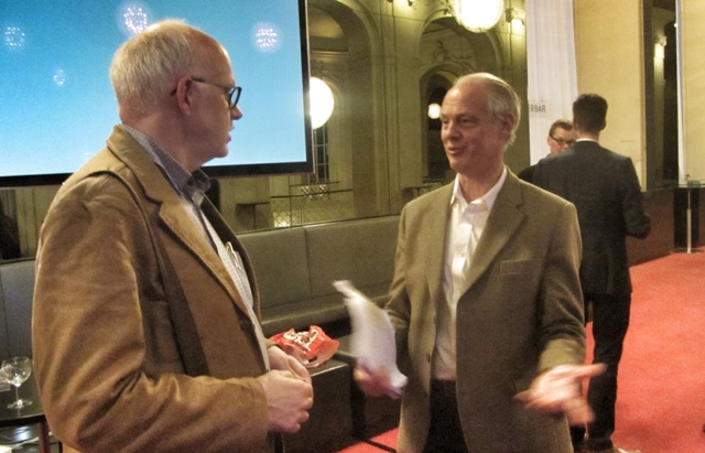 Richard Norton (r) talking to researcher Thomas Krebs from Switzerland at the Operetta Symposium of the Komische Oper.