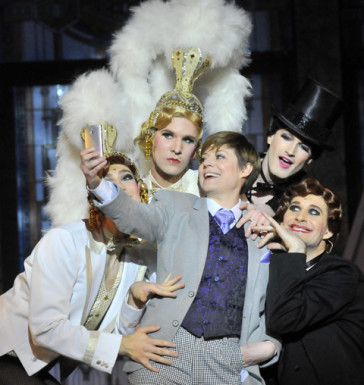 """The dressed up Kató surrounded by cabaret dancers: """"Me and My Little Brother"""" at the Budapest Operettszínhás."""