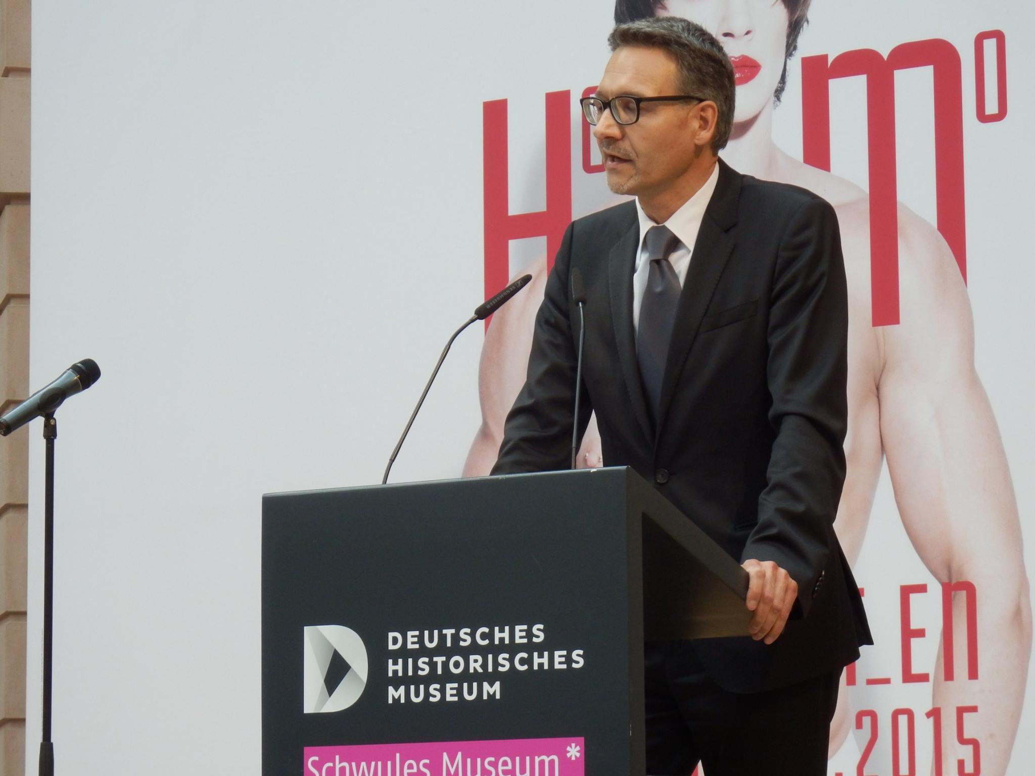 "The director of the DHM, Dr. Alexander Koch, delivering a moving and profound speech at the opening of ""Homosexualität_en."" (Photo: Schwules Museum*)"