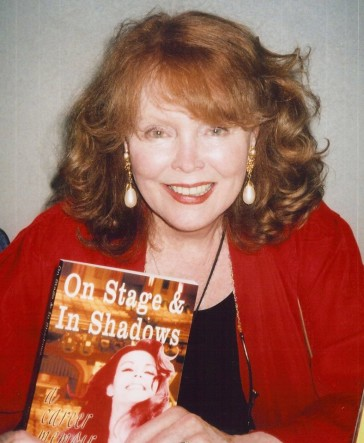"Marie Wallace holding her book ""On Stage and In Shadows."" (Photo: Private)"
