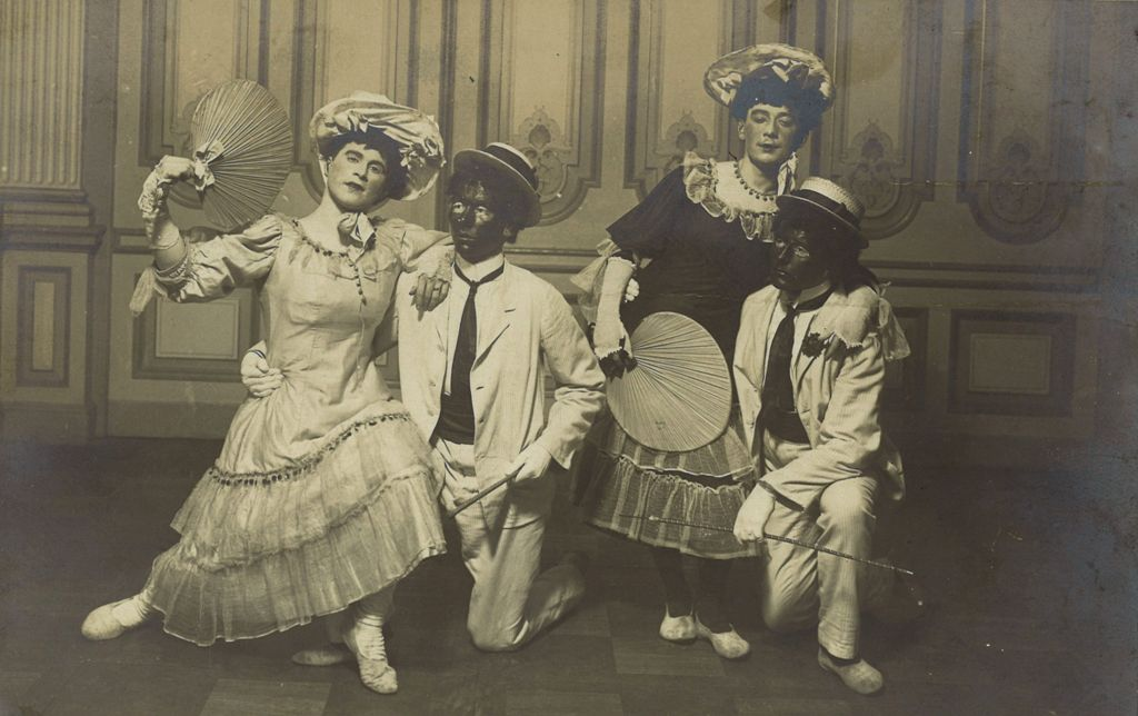 """A group of cross-dressed German performers, together with two """"black face"""" actors at the beginning of the 20th century. (Photo: Schwules Museum*)"""