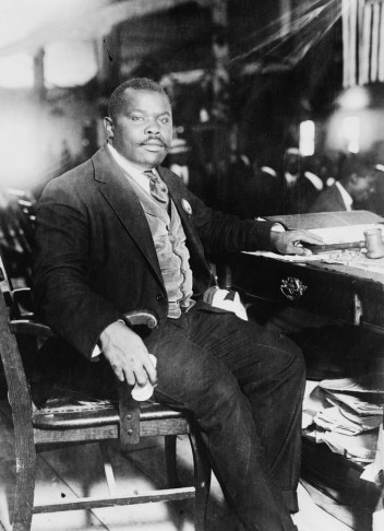 Marcus Garvey, National Hero of Jamaica, seated at desk in 1924. (Photo: Library of Congress)