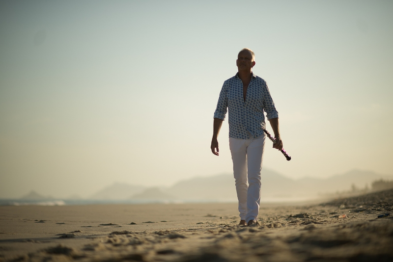 Nigel Shore walking down the beach in Rio de Janeiro. (Photo: Costa Records)