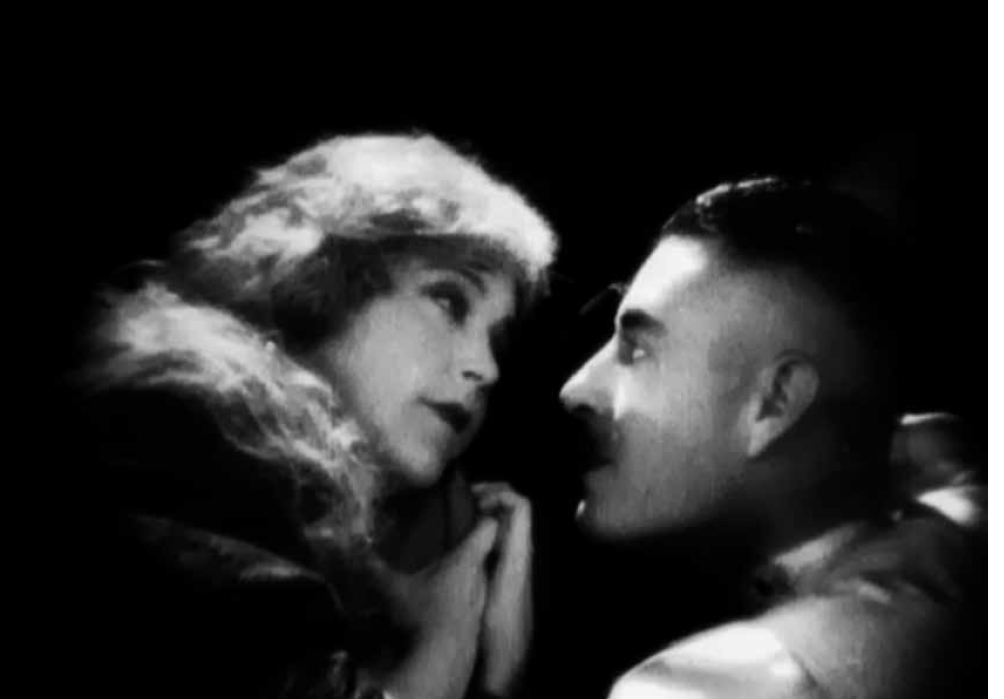 "One of the intimate scenes between Mae Murray and John Gilbert in ""The Merry Widow,"" 1925."