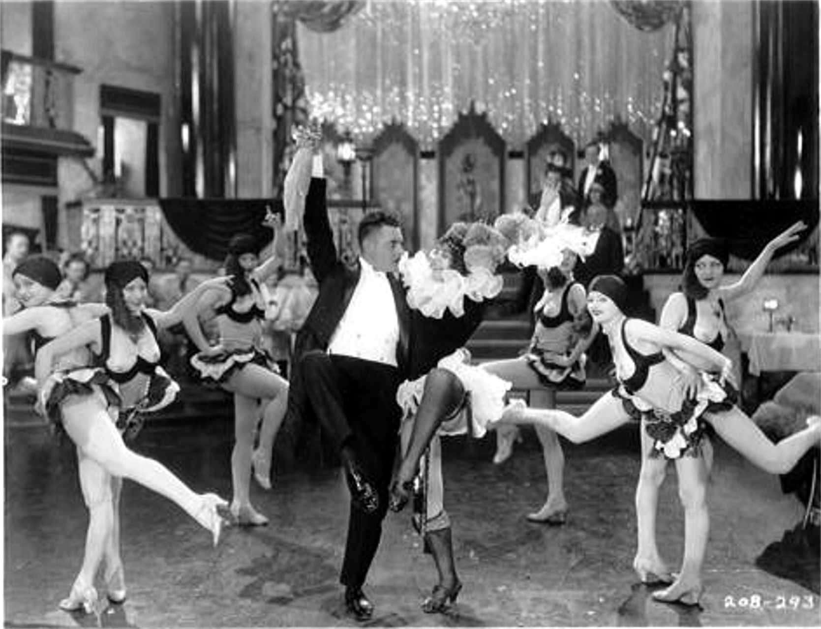 "John Gilbert as Prince Danilo with the can-can girls in ""The Merry Widow,"" 1925. (Photo: Archive Operetta Research Center)"