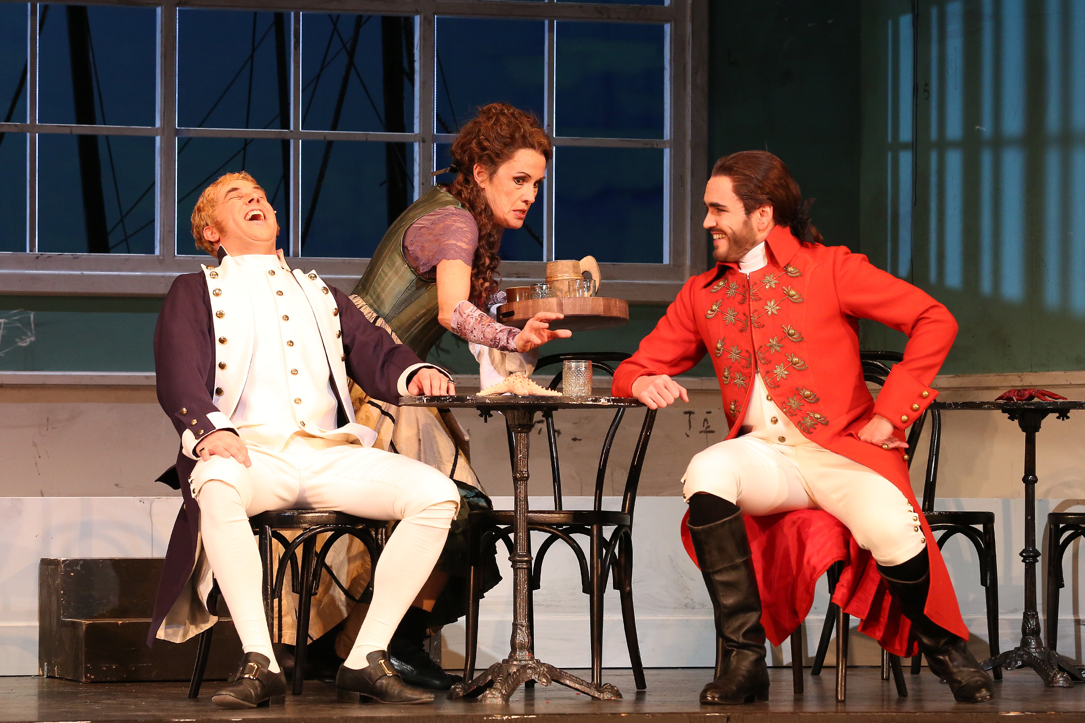 "David Ameln (as Percy Harwich), Christel Ortmann (as Mary Ann), Rodrigo Porras Garulo (as Don Alfredo Bartos) in ""Lady Hamilton."" (Photo: Claudia Heysel)"