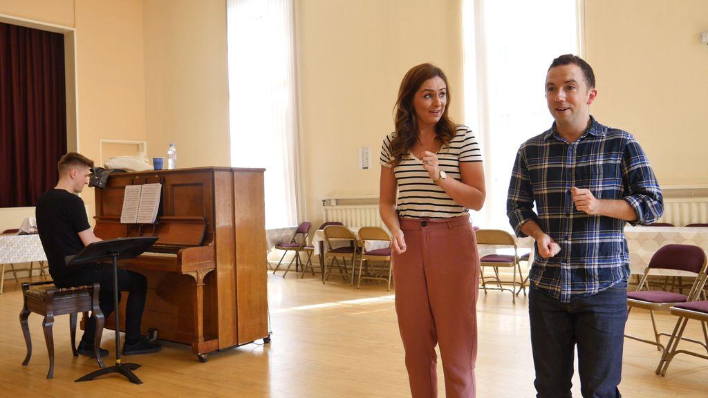 "Soprano Elaine McDaid and tenor William Blake rehearse a duet in ""Tulipatan."" (Photo: Opera Northern Ireland)"