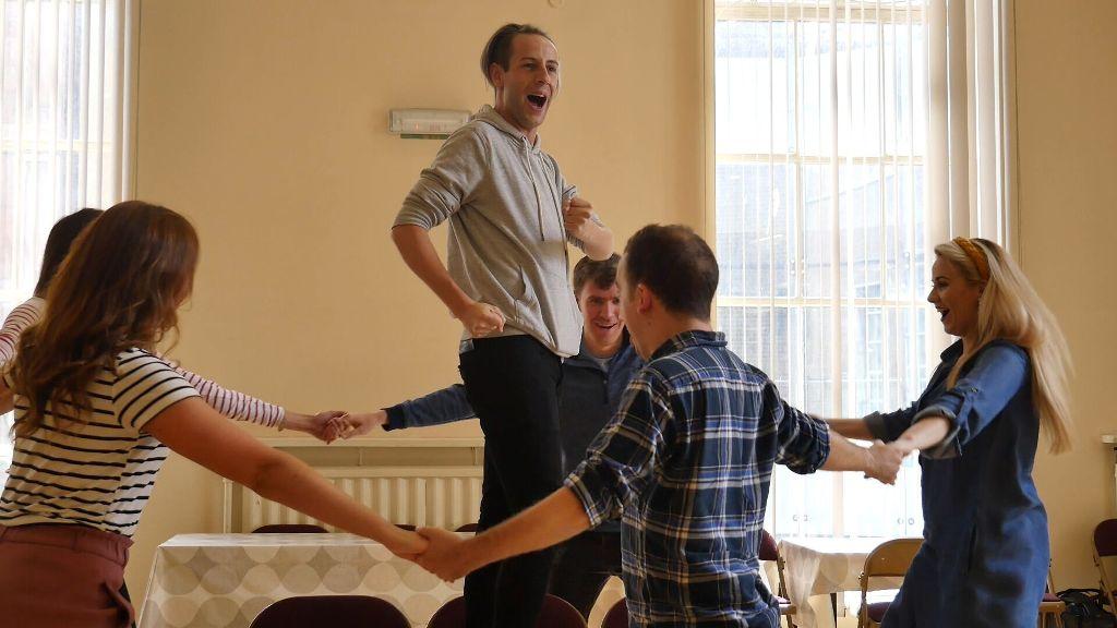 "The ""Tulipatan"" cast rehearsing the operetta finale. (Photo: Opera Northern Ireland)"