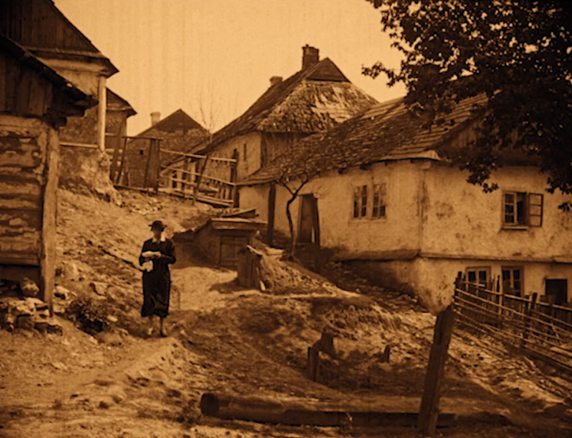 "An anonymous Shtetl, as seen in ""Das alte Gesetz"" with Ernst Deutsch walking down the street. (Screenshot)"
