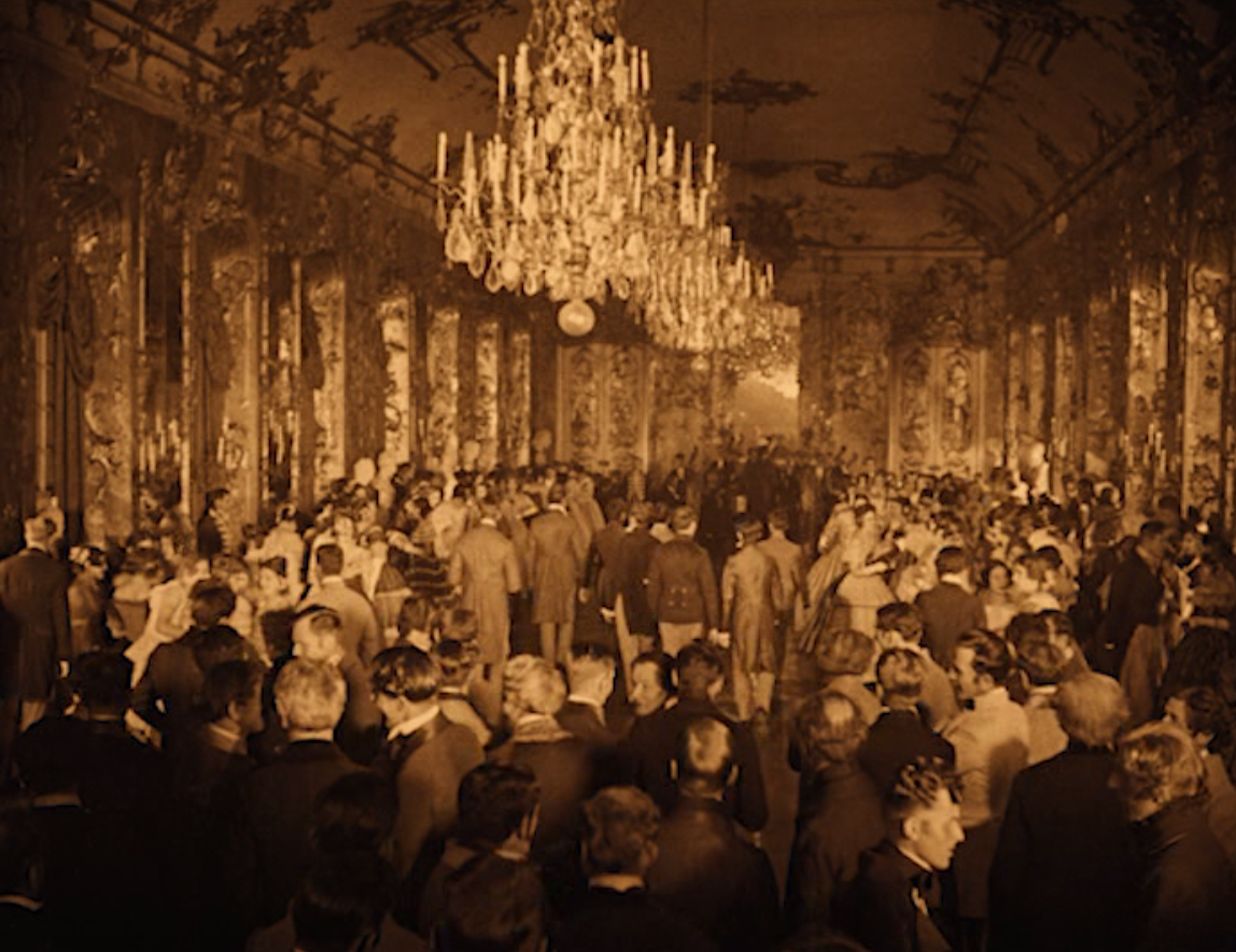 "The grand ball scene in ""Das alte Gesetzt"" with the Johann Strauss orchestra playing in the background. (Screenshot)"