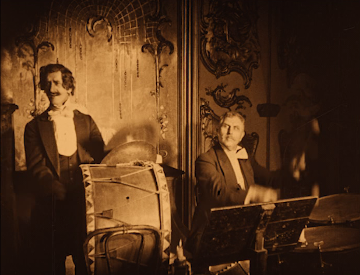 "Members of the Johann Strauss orchestra as seen in ""Das alte Gesetz,"" 1923. (Screenshot)"