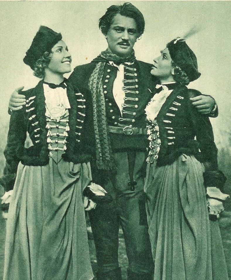 "Adolf Wohlbrück as Sandor Barinkay with Arsena from the two different versions of the film: left, French Daniela Parolo, and right, German Gina Falckenberg. (Photo: from ""Filmwelt"" #46, 1934)"