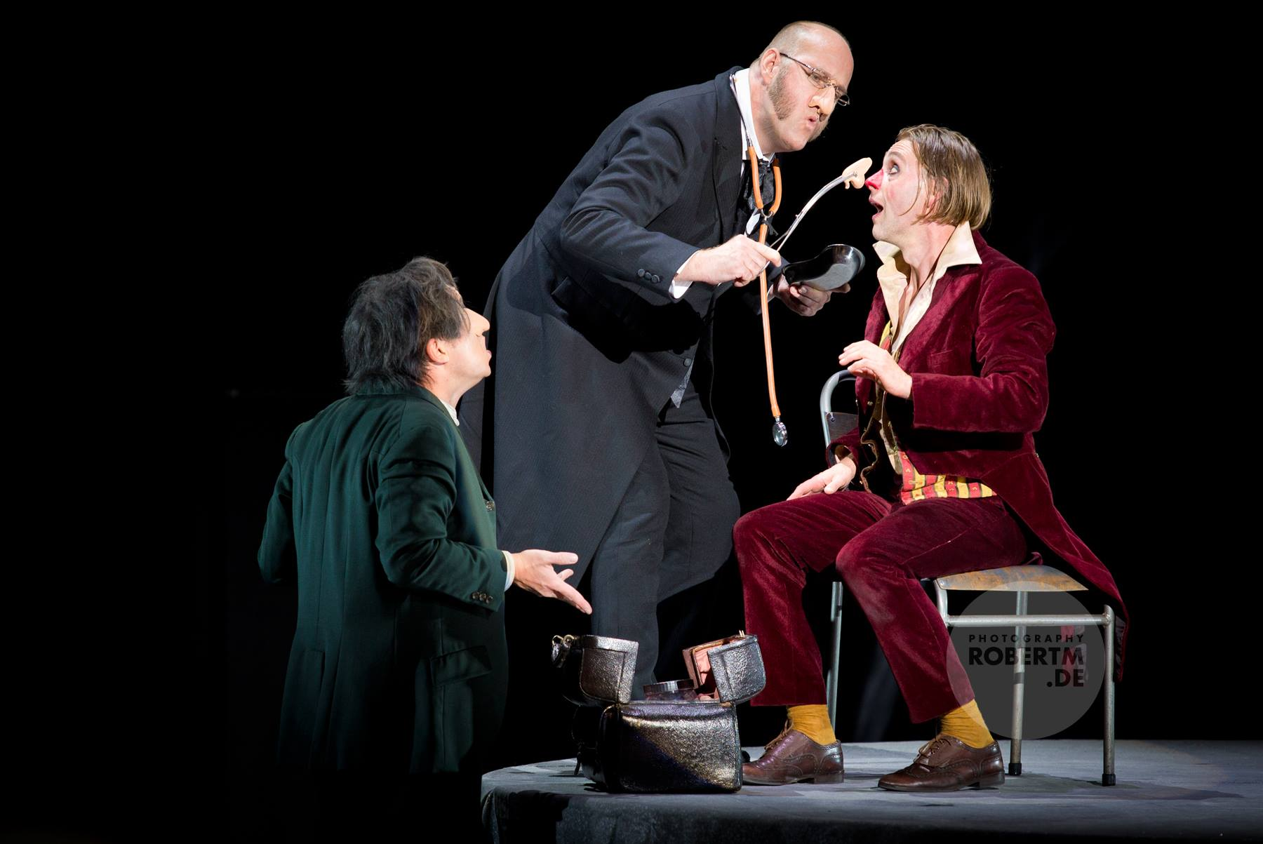 "Trying to fix things: Jens Larsen (middle) and Günter Papendell (r.) in ""Die Nase"" at Komische Oper. (Photo: Robert M Berlin)"