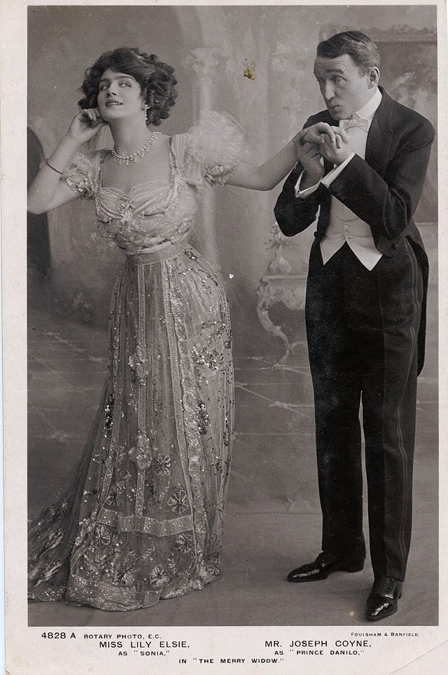 "Lily Elsie and Joseph Coyne in ""The Merry Widow."" In its English adaptation by Basil Hood, with lyrics by Adrian Ross, the show became a sensation at Daly's Theatre in London, opening on 8 June 1907."