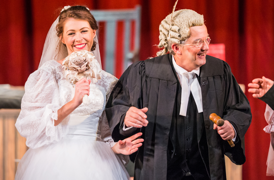 "Ellen Angharad Williams (Plaintiff) and Richard Gauntlett (Learned Judge). ""Trial by Jury"" by the National Gilbert and Sullivan Opera Company, 2018. (Photo: Jane Stokes)"