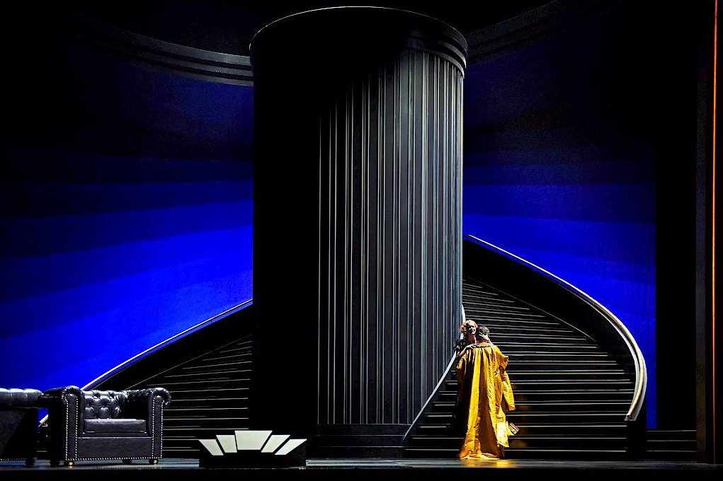 "The double staircase in Andreas Homoki's ""Land des Lächelns"" at Zurich Opera, with Piotr Beczala in a yellow costume. (Photo: Toni Suter / Oper Zürich)"