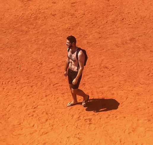 Bass-baritone Romain Dayez walking the desert. (Photo: Instagram/romaindayez)