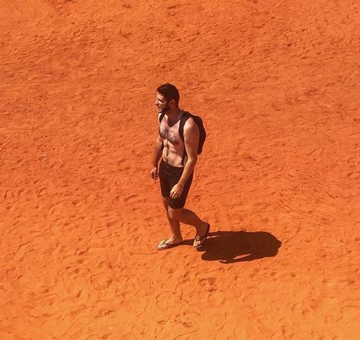 Bass-baritone Romain Dayez walking the desert. (Photo: Instagram/romaindayez)