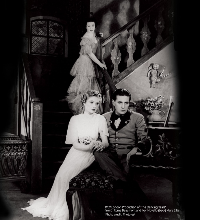 "Ivor Novello and Roma Beaumont as Gretl in the original 1939 production of ""The Dancing Years."" Mary Ellis as Maria Ziegler is seen in the background. Photo from the JAY Records booklet, 2018."