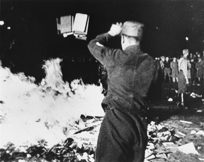 "On May 10, 1933, Nazis in Berlin burned works of Jewish authors, the library of Magnus Hirschfeld's Institut für Sexualwissenschaft, and other works considered ""un-German."" (Photo: United States Holocaust Memorial Museum)"