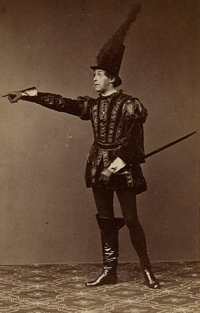 """Wilhelm Knaak in 1860 as the """"blood red"""" Hanns Styx in """"Orpheus in der Unterwelt"""" at Carl-Theater, Vienna. (Photo: Emil Rabending)"""