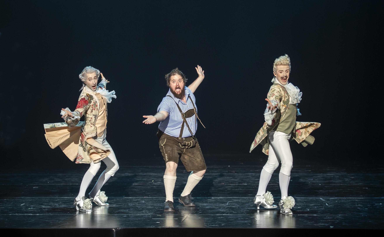 "Allan Clayton with dancers in ""Candide"" at Komische Oper Berlin, directed by Barrie Kosky. (Photo: Monika Ritterhaus)"