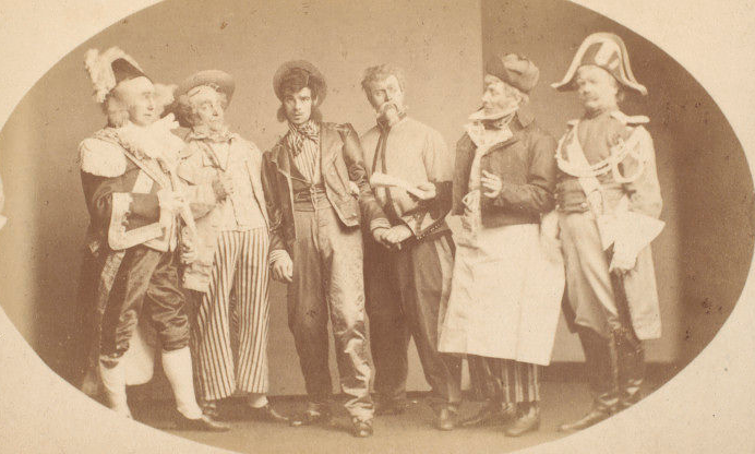 Claude Marius (third from right) in a production at the Strand Theatre, London. (Photo: Kurt Gänzl Archive)