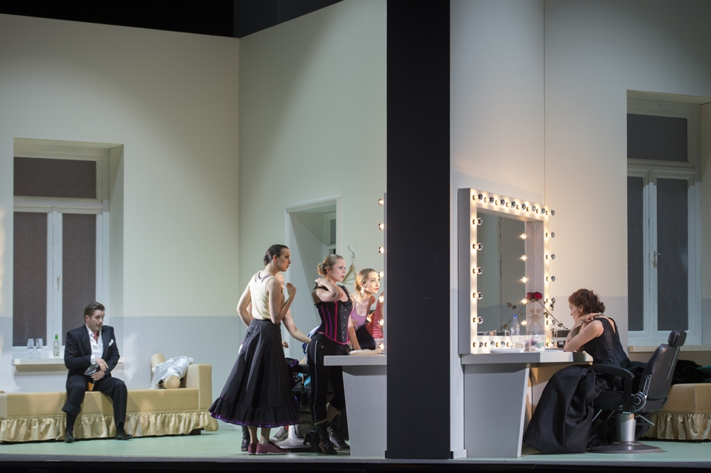 "Iurii Samoilov as Danilo, Grisettes, and Marlis Petersen as Hanna in ""Lustige Witwe"" at Oper Frankfurt, 2018. (Photo: Monika Rittershaus)"