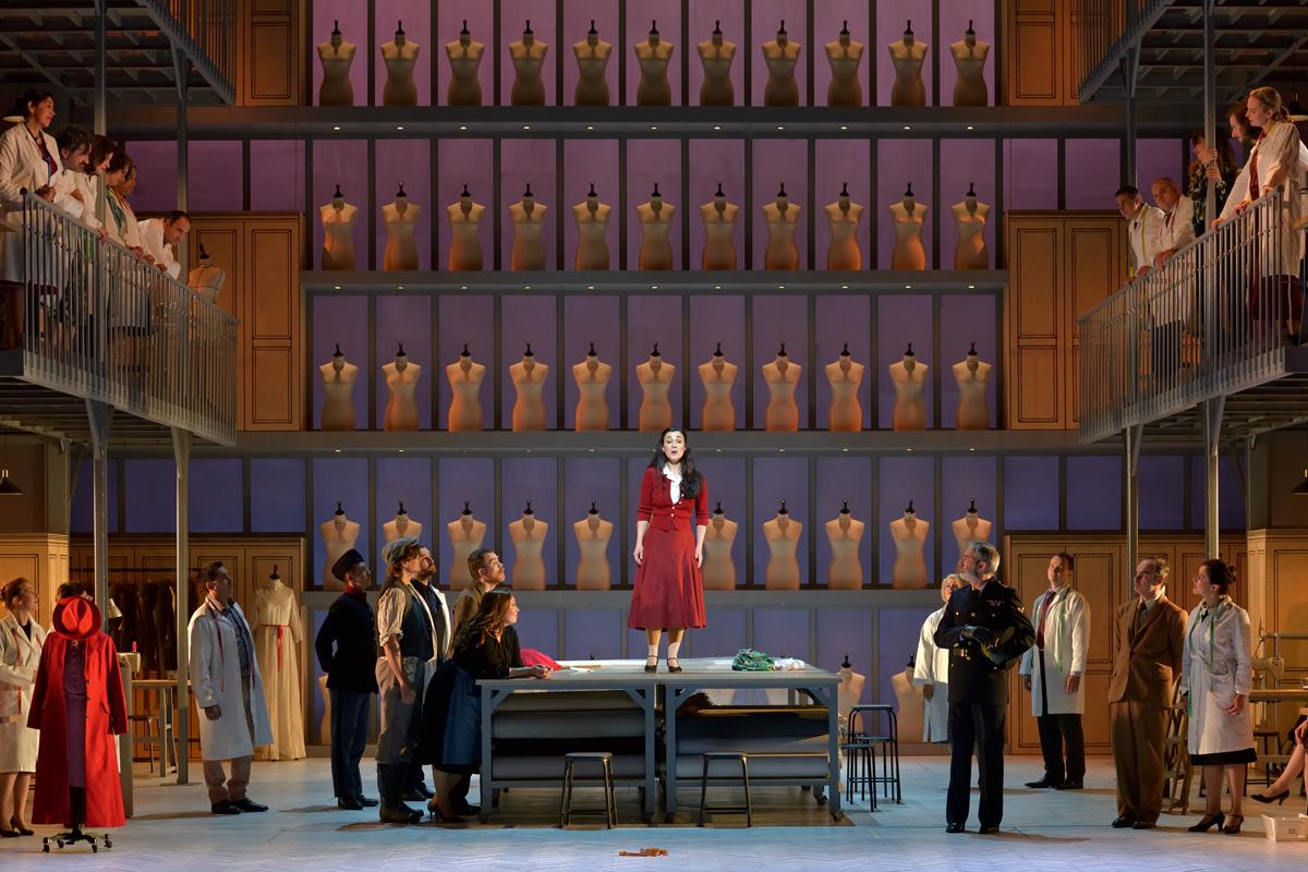 """Suzanne (Anne-Catherine Gillet) with Hector de Boispréau (François Rougier), Biscotin (Lionel Peintre), Major Cotignac (Franck Leguérinel), and the chorus of the Opéra de Limoges in """"Madame Favart"""" at Opéra-Comique, 2019. (Photo: Stéphane Brion)"""