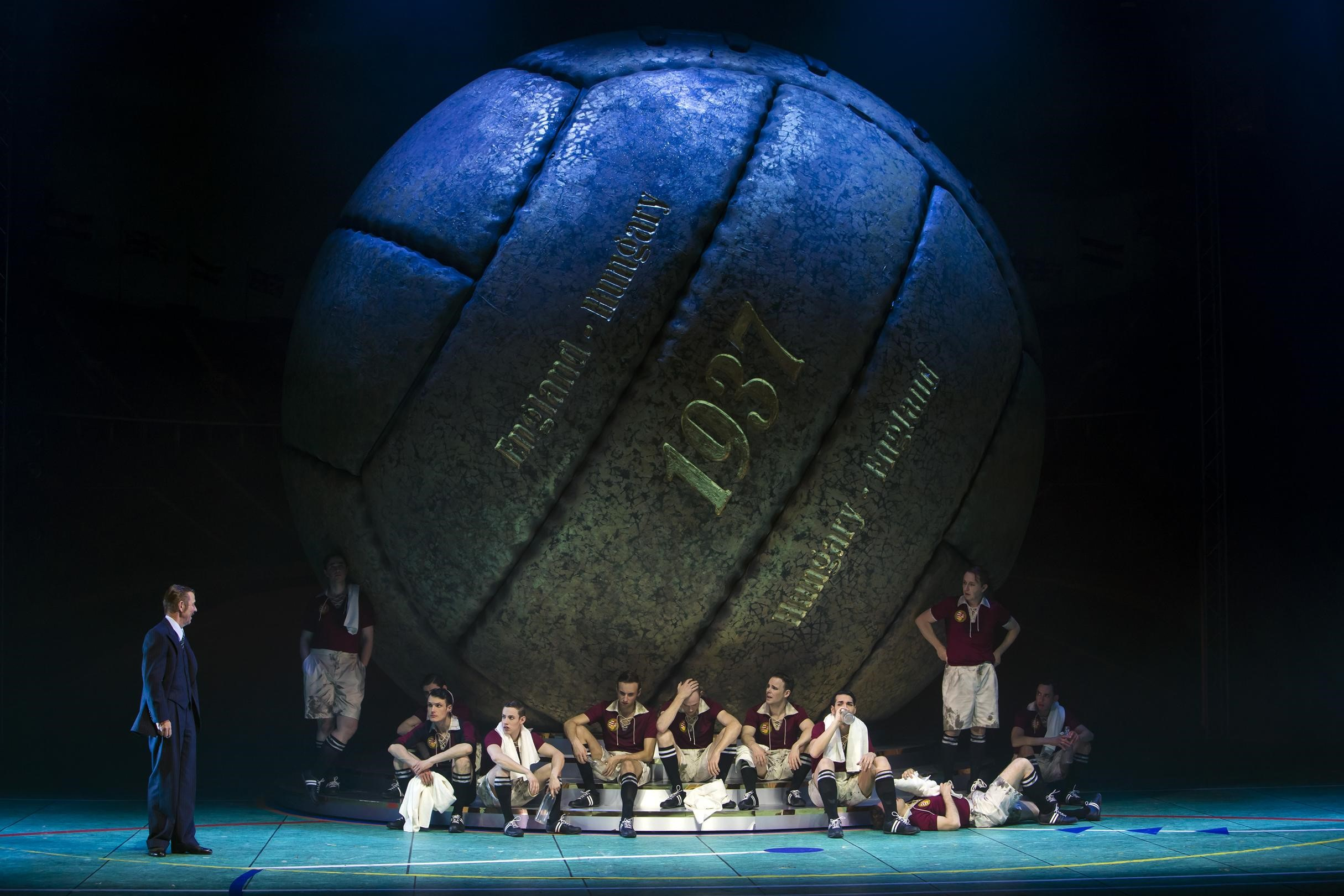 "A giant football with the year 1937 written onto it in the production of ""Roxy und ihr Wunderteam"" at Komische Oper Berlin. (Photo: Iko Freese / drama-berlin.de)"