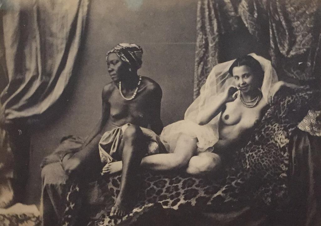 """Black prostitutes shown in Félix-Jacques Moulins """"Études photographiques: l'Odalisque et son esclave,"""" 1853."""
