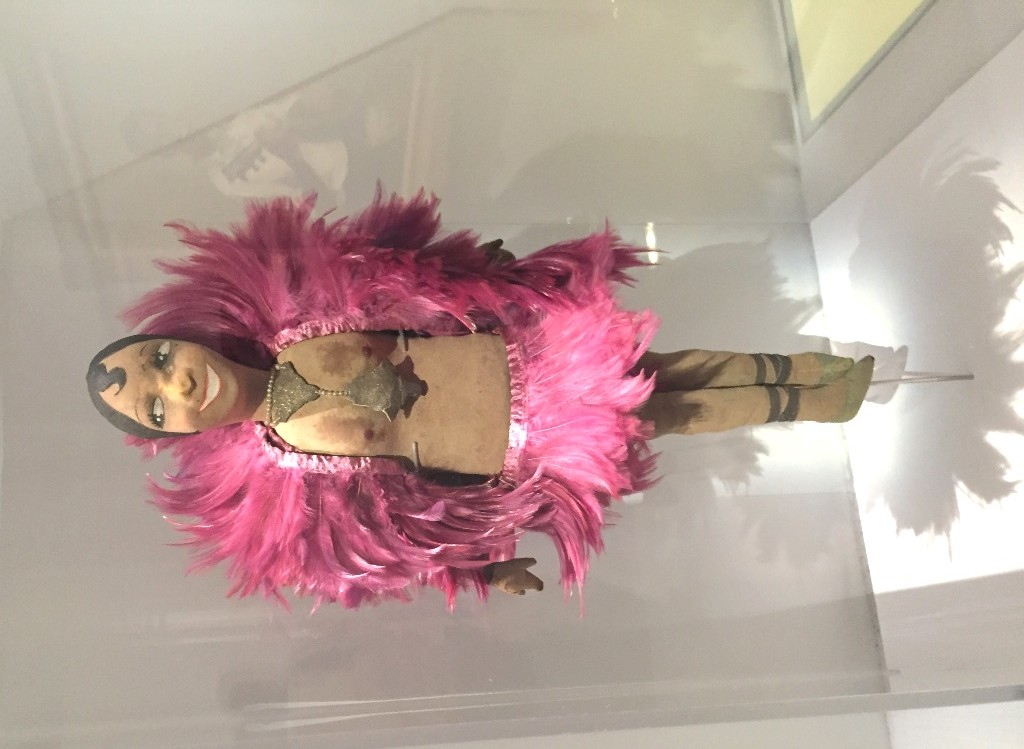 "A doll showing Josephine Baker in pink feathers, as seen in ""Le Modèle Noir"" at the Orsay Museum 2019."