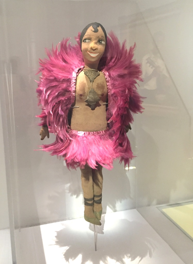 """A doll showing Josephine Baker in pink feathers, as seen in """"Le Modèle Noir"""" at the Orsay Museum 2019."""