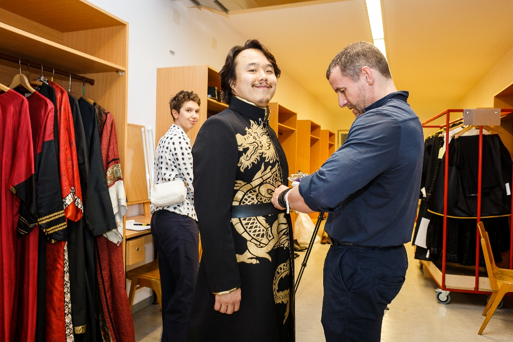 "Tenor Won Whi Choi  putting on his costume for ""Land des Lächelns"" at Mörbisch, 2019. (Photo: Seefestspiele Mörbisch/Jerzy Bin)"