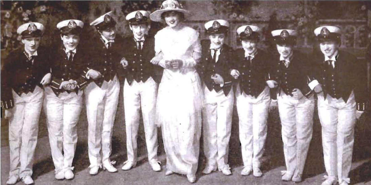 Elaine sings and dances with a chorus of British midshipmen, who are actually women. (Photo: VHRPLive!)