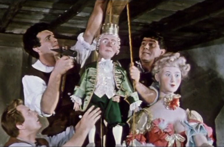 "Campistrel and his friends hand Louis XV and Madame Pompadour as a carnival joke. (Photo: Screenshot from the 1960 DEFA film version of ""Die schöne Lurette"")"
