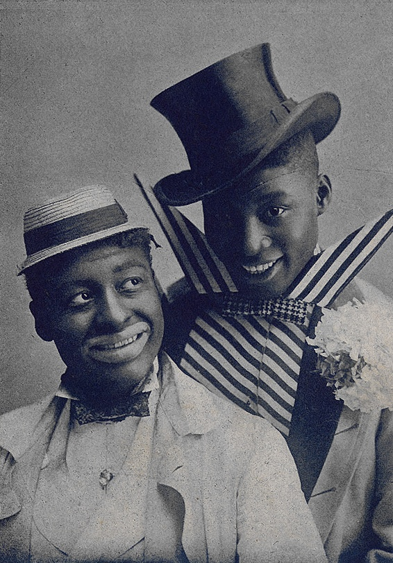 Vaudeville performers Bert Williams (l.) and George Walker in blackface and comic outfits.