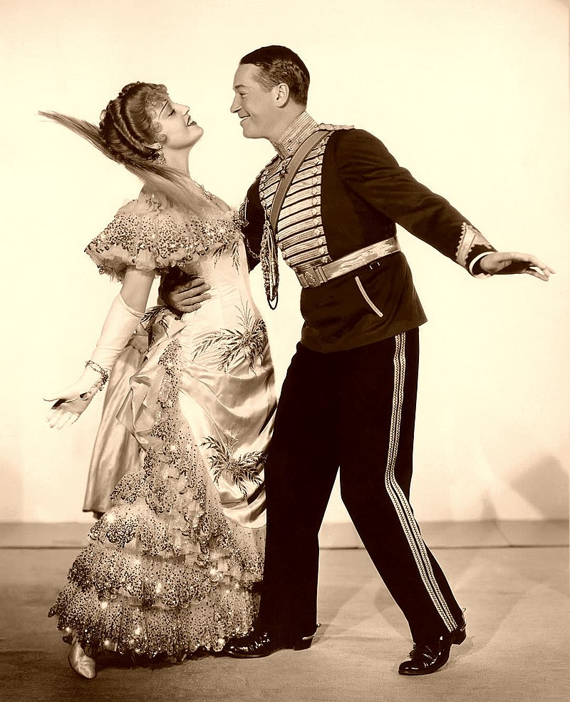 "Jeanette MacDonald with Maurice Chevalier in a promotional still for ""The Merry Widow,"" 1934. (Photo: Unknown / Wikipedia)"