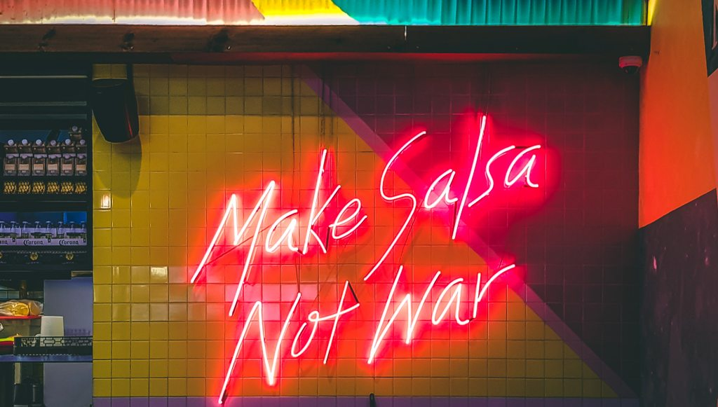 "A Spanish restaurant with lights saying ""Make salsa, not war."" (Photo: Victor Garcia)"