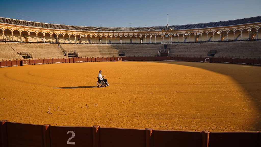 A man in a wheelchair in a bullfighting arena in Southern Spain. Photo: Vidar Nordli Mathisen / Unsplash)