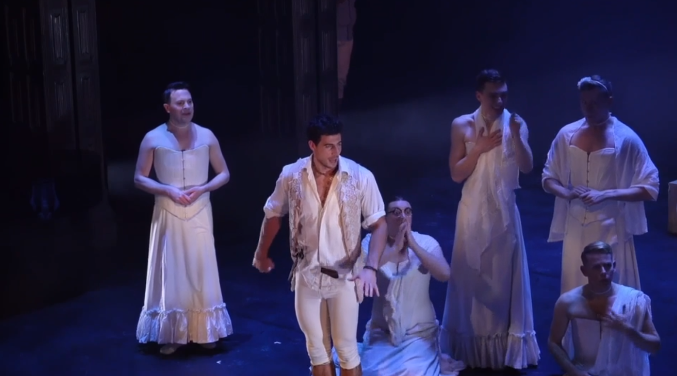 "Tom Senior as Frederick with Alan Richardson (l.) as Mabel and her Cornish sisters, in Sasha Regan's ""Pirates of Penzance,"" 2020. (Photo: Screenshot)"