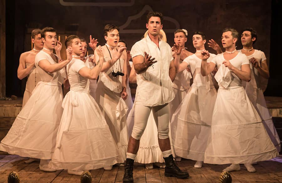 Tom Senior as young Frederick with the daughters of General Stanley, as seen back at Wilton's Music Hall in a previous staging by Sasha Regan. (Photo: Scott Rylander)